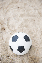 football on sand beach