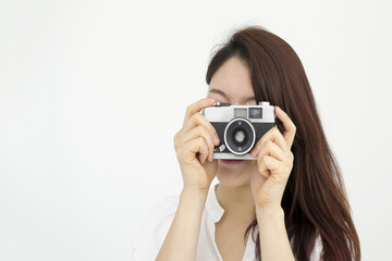 Asian young woman taking photo by old film camera