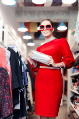 Woman wearing red dress in fashion store