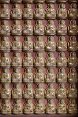 many image Buddha on the wall