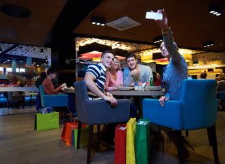 friends have lanch break in shopping mall