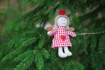 Handmade doll on christmas tree