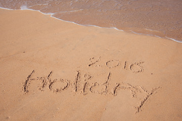Holiday 2016 handwriting on sand