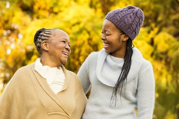 Mother and grandmother smiling to each other