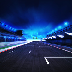 finish drive on the racetrack in motion blur with stadium and spotlights