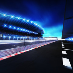 racetrack finish area with box line and shining spotlights