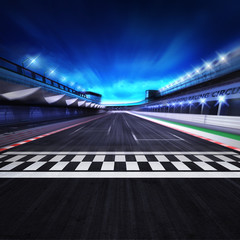 finish line on the racetrack in motion blur with stadium and spotlights