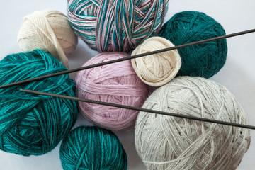 balls of yarn and needles