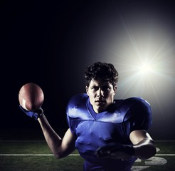 Composite image of portrait of sportsman throwing football