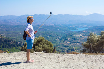 Tourist making selfie against the backdrop of beautiful scenery
