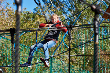 Girl is climbing to amusement park