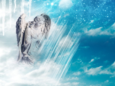 an angel statue over mystical sky with divine light and stars