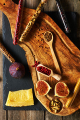 Olive wood cutting board with spices and fig