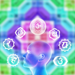 a male head with seven symbols of chakra over colorful background