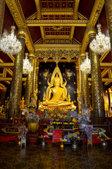 Thai people praying Buddha statue name Phra phuttha chinnarat at