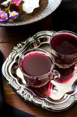 Fresh red grape juice and flowers