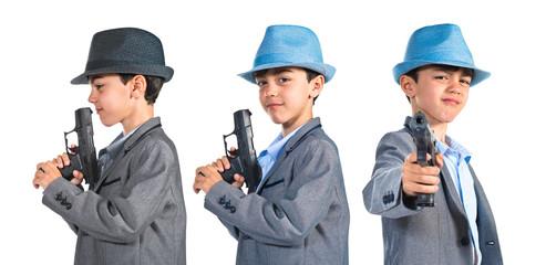 Gangster boy holding a gun