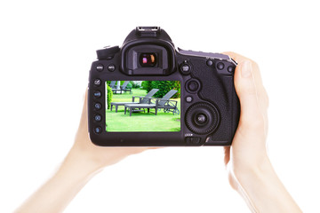 Photographer with camera at work, isolated on white