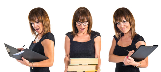 Woman holding a lot of books