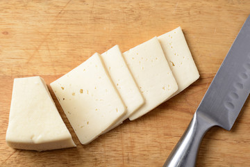 Cut cheese on a wooden board