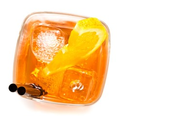Fototapete - top of view of glass of spritz aperitif aperol cocktail with orange slices and ice cubes