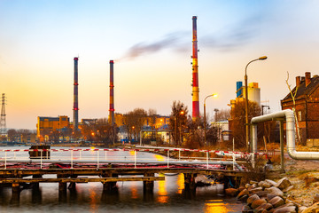 Industry area - CHP with high chimneys at dusk.