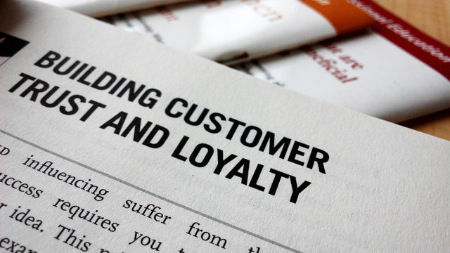 Buiding customer trust and loyalty word on a book
