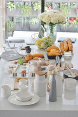Pastries and breads setting on white top dining table