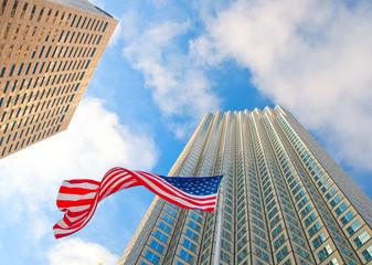 Miami Florida, downtown buildings and waving American flag, low perspective view