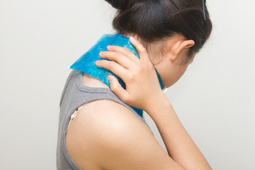 woman putting gel pack on swollen neck
