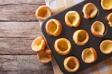 Yorkshire puddings in baking dish on the table. horizontal top view