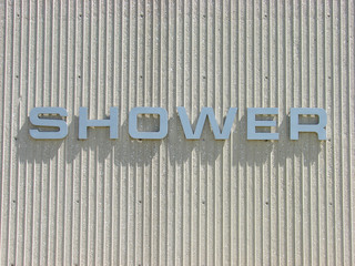 shower sign on concrete wall