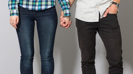 young couple holding hands Close-up