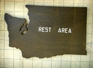 aged and worn vintage photo washington state map rest area sign