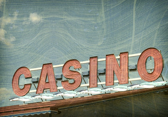aged and worn vintage photo of red casino sign