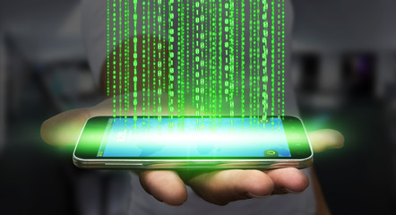 Businessman downloading software on his mobile phone