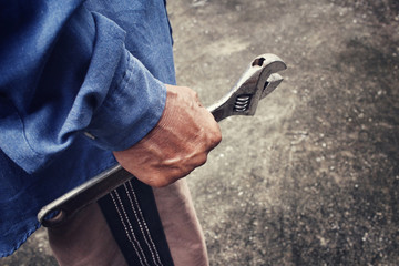 Man with adjustable wrench tool