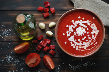 Gazpacho with cream and ingredients, top view, studio shot