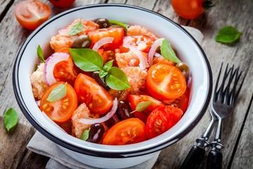 panzanella: Italian salad with tomatoes, ciabatta, olives, red onion and basil