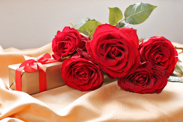 Bouquet  of red roses  on golden tablecloth