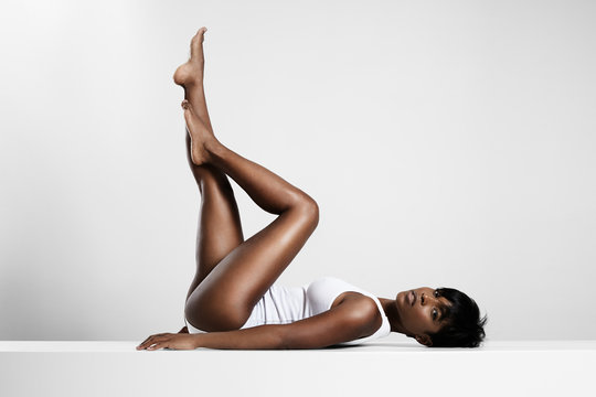 black woman put up her legs and crossed them