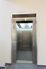 Open elevator door in hotel lobby