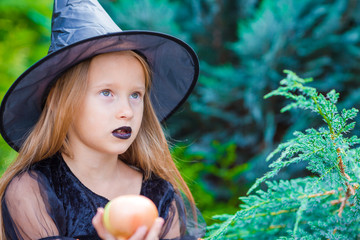 Wall Mural - Little adorable girl in halloween costume with big onion outdoor