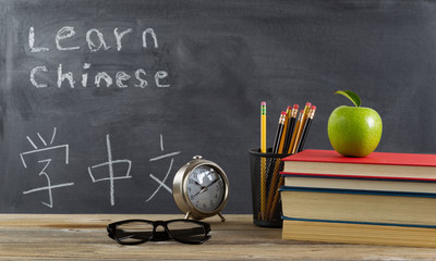 Student desktop prepared to learn Chinese language