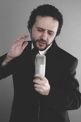 Musician, artist of the song, singer suit and microphone