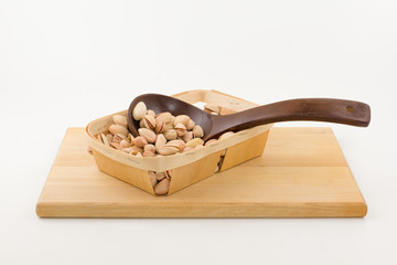 kitchen utensils with wooden containers full of nuts