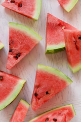 Sliced watermelon on wooden table closeup