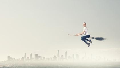Girl fly on broom