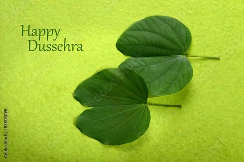 Indian festival dussehra showing golden leaf on green background indian festival dussehra showing golden leaf on green background greeting card m4hsunfo