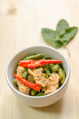 Spicy stir fried pork with red curry paste and Yard Long bean, T